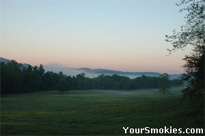 Dawn breaks over mountains surrounding Cades Cove.