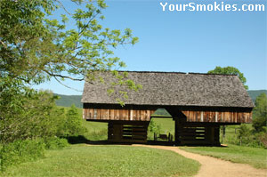 Beautiful cantilever style barn & horse drawn wagon.